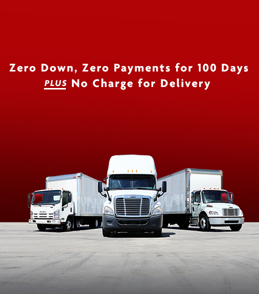 white commercial trucks lineup with zero down, zero payments for 100 days plus no charge for delivery text above